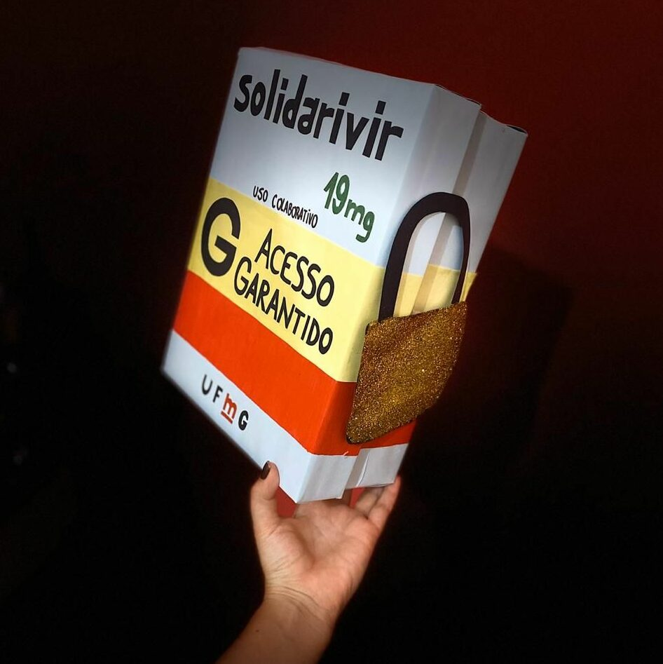 """A hand holds up a box of medicine labeled """"Solidarivir"""""""